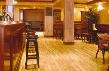 "Elegant wood effect Polyflor Kudos PU luxury vinyl tiles - from commercial flooring specialists Polyflor Ltd - add an extra touch of class to the new ""Sophisticats"" bar at the Hamilton Town Hotel in Hamilton, near Glasgow, UK."